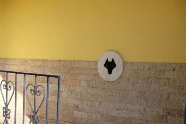 """What is this I hear you ask? An Ancient Greek symbol for power? A symbol of Artemis, God of the animals? No! It is the Wolverhampton Wanderers logo and the man sitting in the doorway of this house leant out and, in the strongest Wolverhampton accent, said: """"that's my football team love""""."""