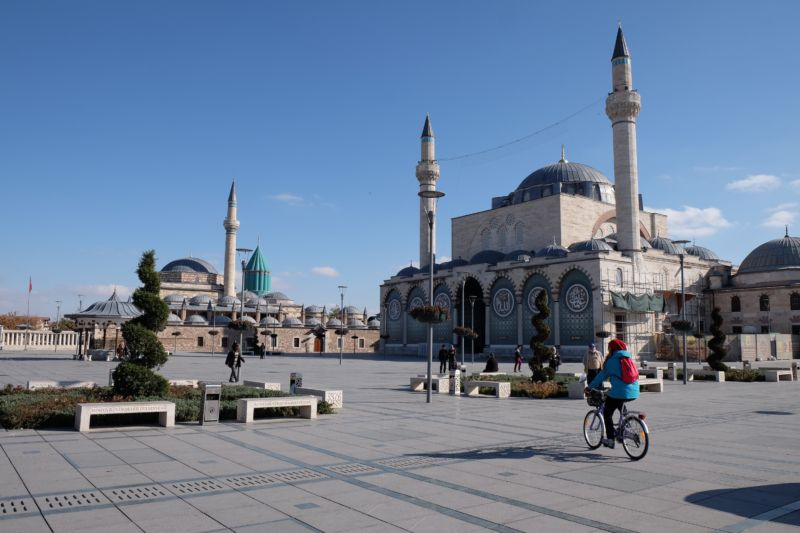 This is the Mevlana Museum (Mevlana means master and is another way refer to Rumi) and summary of Rumi's life and about the Mevlana order. In the foreground is Nuran, a fellow Konya cyclists