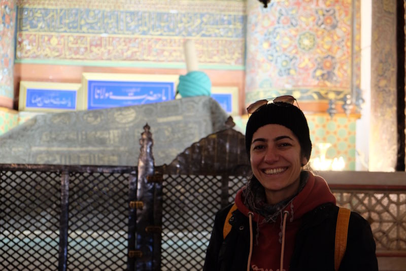 This is my lovely Konya host Ebru standing in front of Rumi's tomb, with the iconic Sufi order hat sitting on the coffin