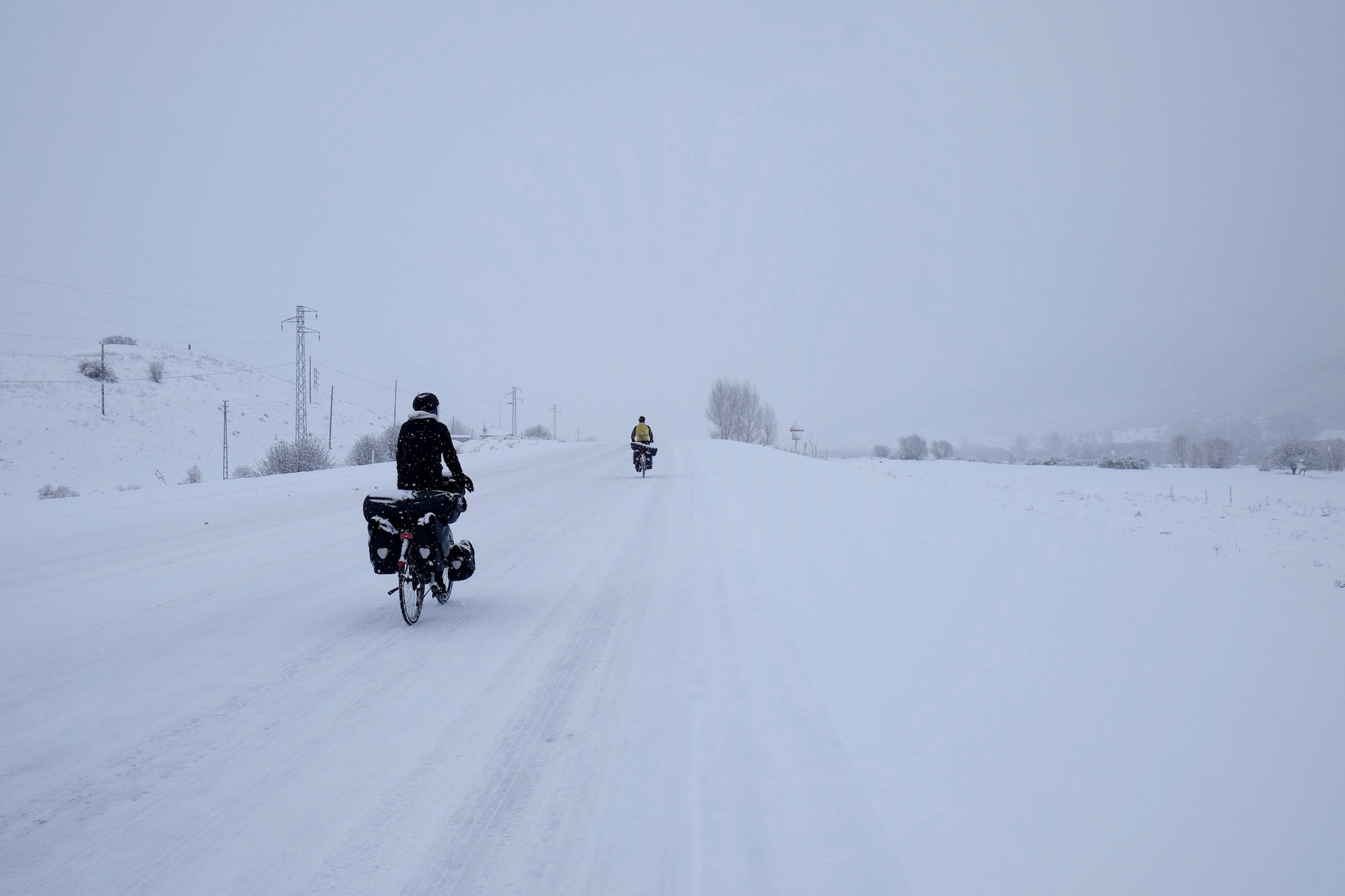 "It is lovely to cycle with other cyclists, predominantly because you laugh so much together. However, another benefit of sharing your trip with others is that when you are cycling along three inch deep freshly fallen snow in -8°c, you can look ahead at the German couple you are cycling with and think ""well if I'm a little crazy to be doing this, at least they are too""."