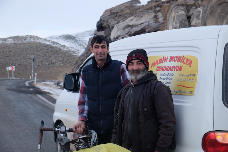 "A section of road between Kars and Cildir was described as impossible to pass by bike. I am so regularly told that it is ""impossible"" or ""too dangerous"" to cycle that turns out to be complete nonsense, it is difficult to know when to listen to local advice. These guys were so kind and so concerned about this bit of road that I decided to take the lift along this 10km stretch of road they deemed impassable. The snow was pretty deep and the side winds looked to be around 30km/hr so although possible, it was nice to observe the conditions from the inside of the warm van."